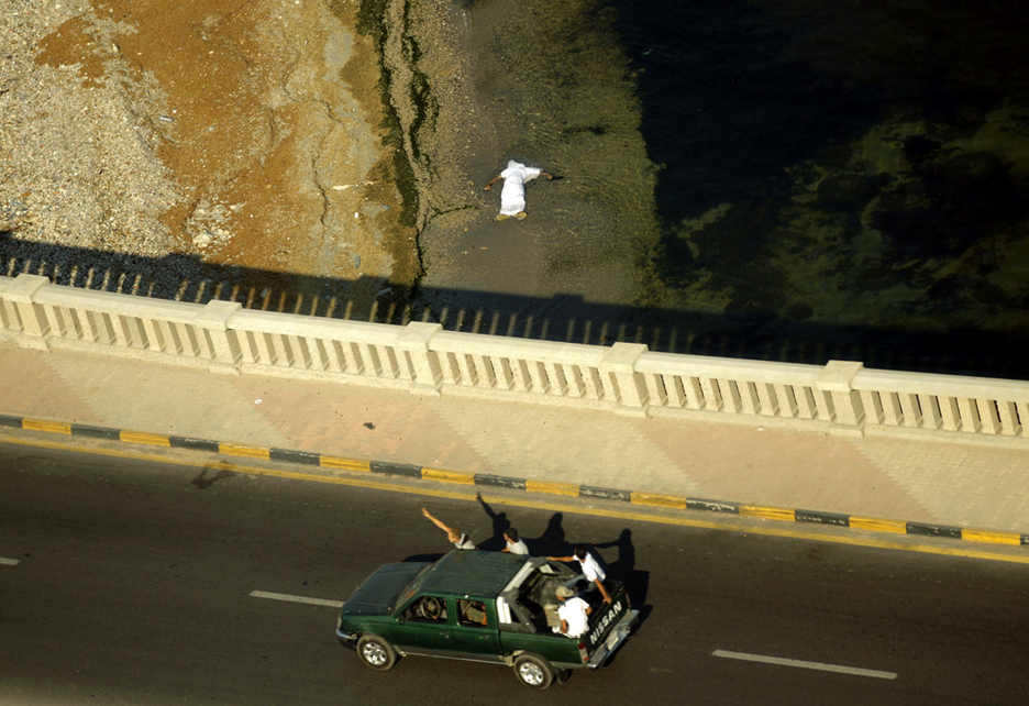 Libyan-rebels-patrol-Tripoli-body-in-sea-082511-by-Patrick-Baz-AFP-Getty, The truth about the situation in Libya, World News & Views