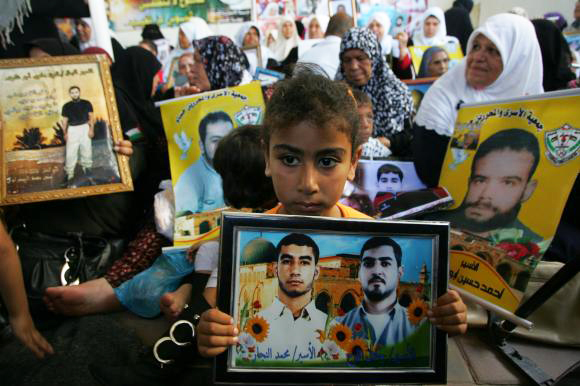 Palestinian-prisoners-families-protest-Gaza-City-062810-by-Ismael-Mohamad-UPI, Palestinian prison hunger strikers declare solidarity with California prison hunger strikers, Behind Enemy Lines