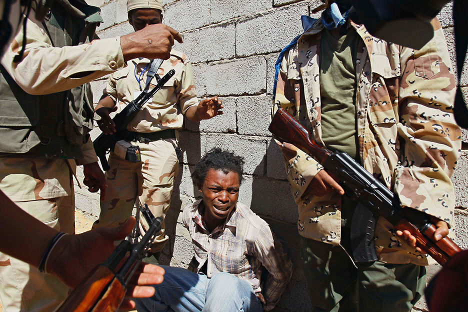 Rebels-arrest-Nigerian-in-Mahruga-Libya-091711-by-Francois-Mori-AP, Imperialism will be buried in Africa, World News & Views