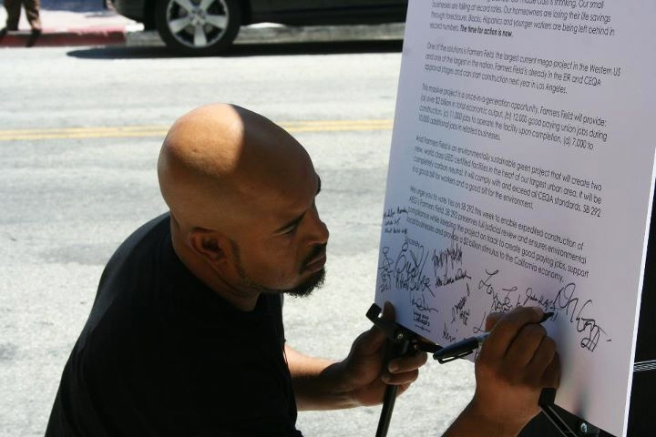 Unemployed-apprentice-electrician-Jabari-Blount-signs-a-letter-urging-Sen.-Lowenthal-to-support-SB-292-Long-Beach-090811-by-LA-Fed-Labor, Black workers leading the charge, National News & Views