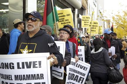 Dec-12th-Movement-Qaddafi-rally-at-Harlem-State-Office-Bldg-102211, Venezuela's Chávez condemns assassination of Qaddafi as 'disregard for life', World News & Views