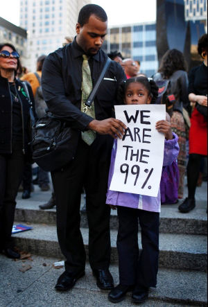 Little-Black-girl-sign-We-are-the-99-percent-by-Mike-Segar-Reuters, Occupy Wall Street cops and mobbers, National News & Views World News & Views