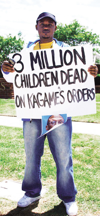 Anti-Kagame-protest-at-Okla.-Christian-Univ.-Claude-Gatebuke-3-mil-children-dead-sign-re-Congo-043010-by-Kendall-Brown1, Rwanda Genocide survivor: My mother and I were ordered to dig our own graves, World News & Views