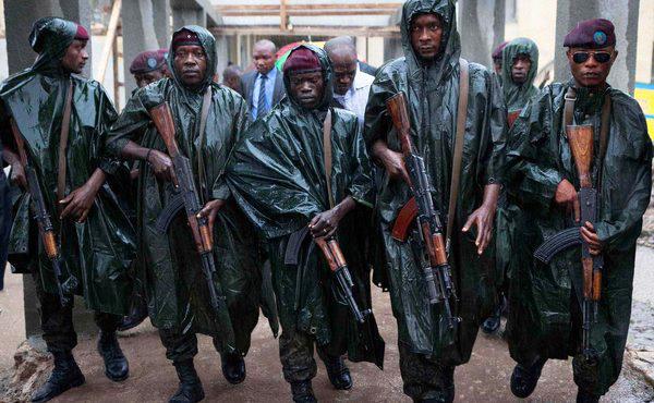 Congo-Pres.-Kabila%E2%80%99s-Republican-Guard-walk-ahead-as-he-leaves-polling-station-after-voting-112811-by-Finbarr-O%E2%80%99Reilly-Reuters, Kabila, Tshisekedi, Congo and the International Criminal Court, World News & Views