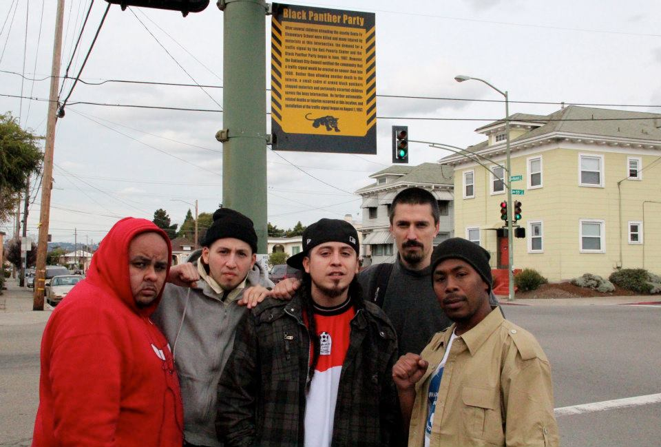 Dj-Illinoiz-G1-Rodstarz-JR-at-55th-Market-No.-Oakland-Black-Panthers'-stoplight-on-Rebel-Diaz'-OccupytheAirwaves-Tour-1111, Occupy the Airwaves: an interview wit' the rap group Rebel Diaz, Culture Currents