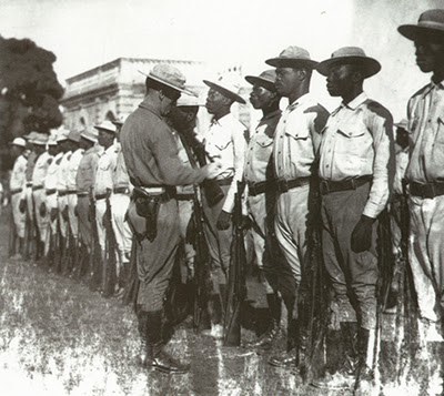 U.S.-Marine-officer-inspects-Haitian-Gendarme-unit-first-occupation-1915-34, 'Harvest of Hope': Kevin Pina documentary on Haitian army, with review by Dady Chery, Culture Currents