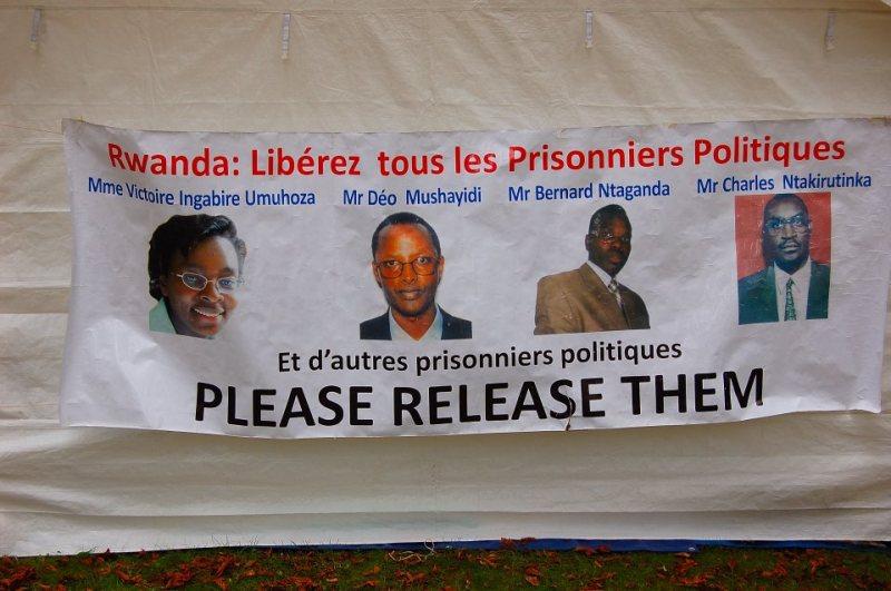 Banner-Rwanda-Free-all-political-prisoners-for-Paris-march-091211, Rwanda will never be the same, after Victoire Ingabire's return, World News & Views