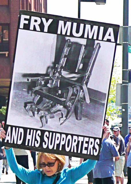 Fry-Mumia-and-his-supporters-white-woman, 'People Power' pries Abu-Jamal from punitive administrative custody, Behind Enemy Lines