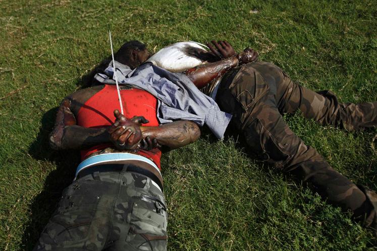 Libya-Blacks-handcuffed-executed-web, Cynthia McKinney: 12,000 U.S. troops bound for Libya, World News & Views