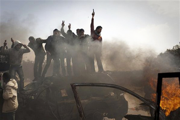 Libyan-rebels-celebrate-on-Qaddafi-tank-hit-by-US-NATO-poss.-DU-missile-may-be-inhaling-toxic-uranium-oxide, A sourcebook for the media revolution, Culture Currents