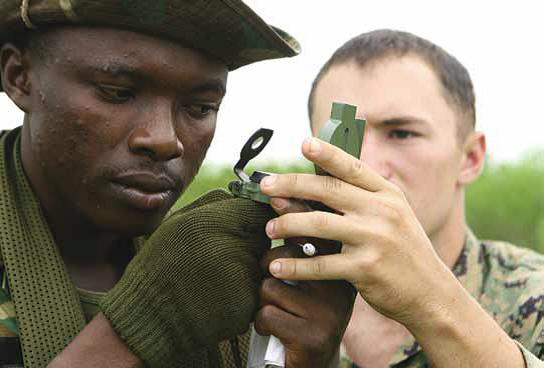 US-Marine-teaches-Ghanaian-soldier-to-use-compass-during-military-to-military-familiarization-event-c.-2008-by-Nicole-Teat-US-Marine-Corps, Cynthia McKinney: U.S. war machine pervades Africa, World News & Views