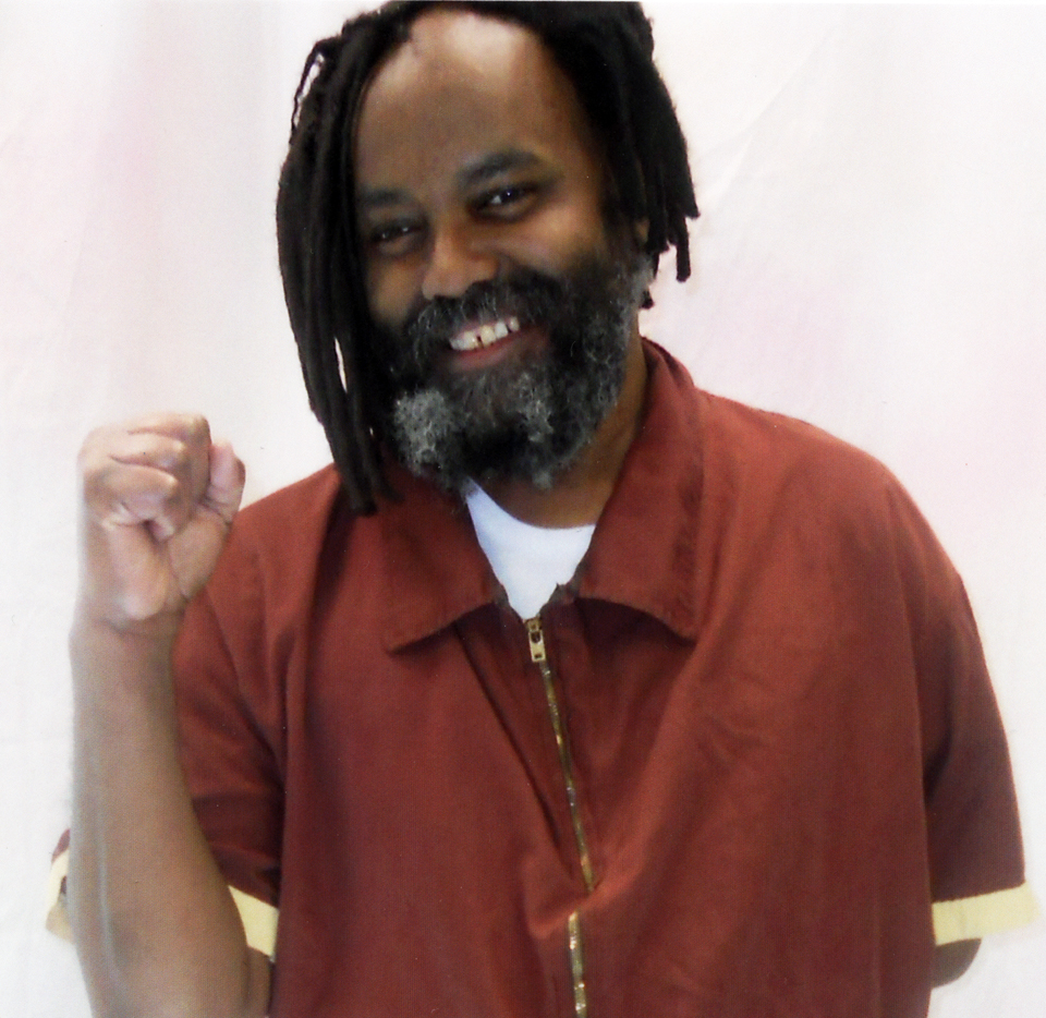 Mumia-raised-fist-020612-web, Mumia calls on you to 'Occupy 4 Prisoners' Monday, Feb. 20, Behind Enemy Lines