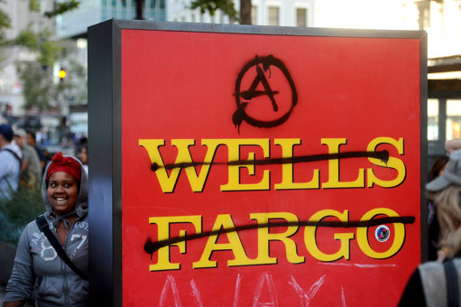 Occupy-Oakland-General-Strike-Wells-Fargo-sign-defaced-young-Black-woman-gleeful-110211-by-Noah-Berger-AP, A discussion on strategy for the Occupy Movement from behind enemy lines, Behind Enemy Lines