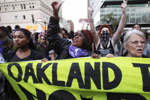 Occupy-Oakland-angry-women-march-near-City-Hall-after-eviction-102511-by-Reuters, A discussion on strategy for the Occupy Movement from behind enemy lines, Behind Enemy Lines