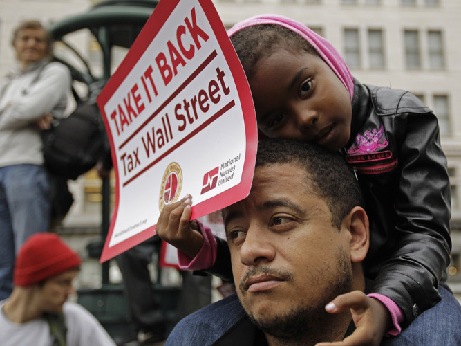 Occupy-Oakland-banks-protest-Black-dad-Manuel-Riley-Kamayah-Riley-5-Take-it-back-Tax-Wall-Street-101011-by-Ben-Margot, A discussion on strategy for the Occupy Movement from behind enemy lines, Behind Enemy Lines