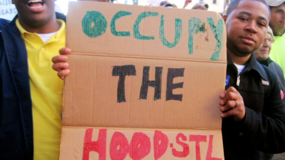 Occupy-St.-Louis-Occupy-the-Hood-sign, A discussion on strategy for the Occupy Movement from behind enemy lines, Behind Enemy Lines
