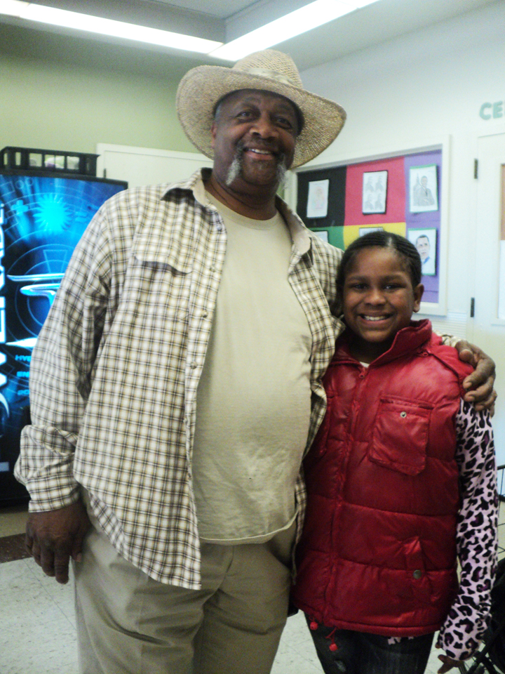Rainbow-Recreation-Center-food-giveaway-co-founder-Lonnie-Scoggins-granddaughter-012812-by-Wanda, Wanda's Picks for February 2012, Culture Currents