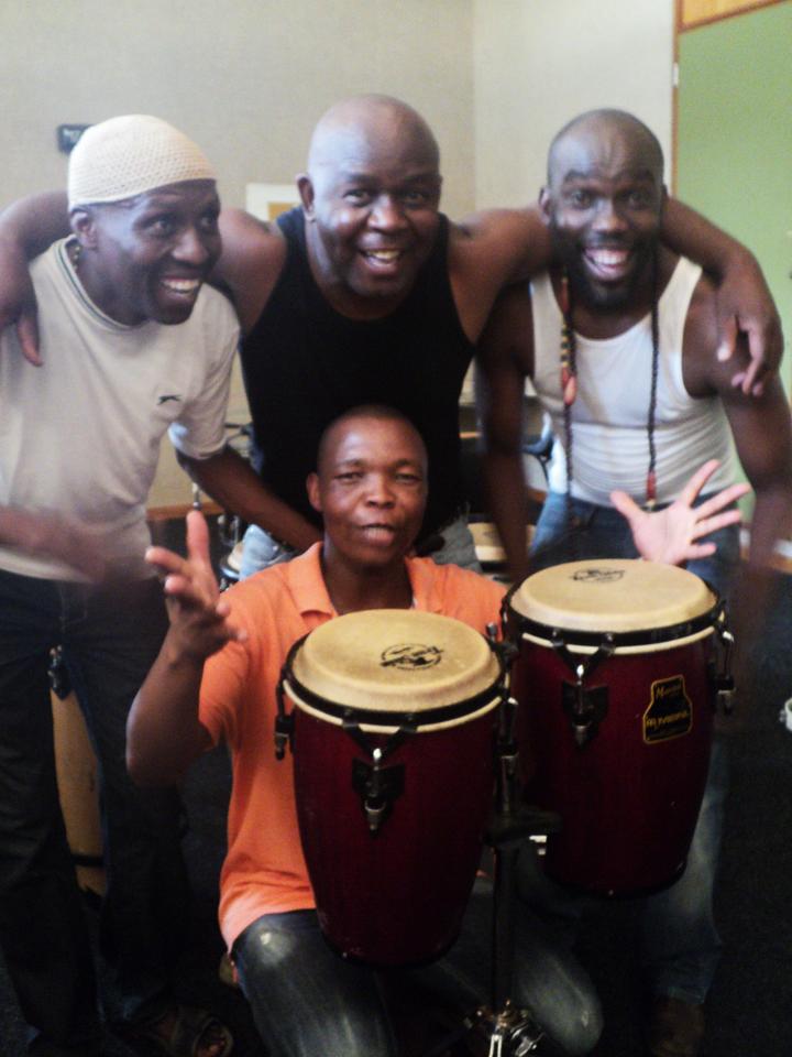 South-Africa-percussion-ensemble-Motshepe-Kgawane-Lulu-'Abu-Bakr'-Tseola-Joseph-Mmaphuti-Kgomo-Paepae-Kenneth-Mmekwa-in-front-of-drums-Pretoria-0112-by-Wanda, Wanda's Picks for February 2012, Culture Currents