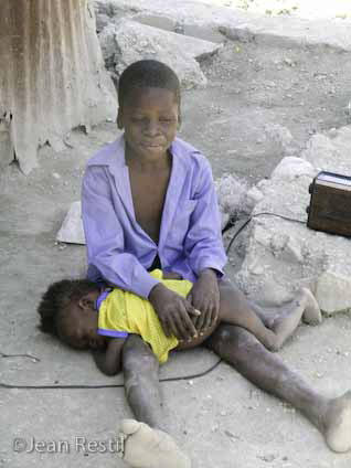 Cite-Soleil-children-nourished-by-mud-cookies-by-Jean-Ristil, Tribute to Jean Ristil Jean Baptiste, World News & Views