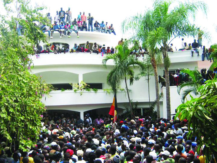Haitian-crowd-awaits-Aristides-at-their-home-031811-by-Jean-Ristil-Jean-Baptiste1, Tribute to Jean Ristil Jean Baptiste, World News & Views