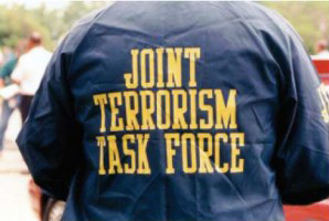 Joint-Terrorism-Task-Force-shirted-officer, Spying on San Franciscans: End FBI control of SFPD Joint Terrorism Task Force, Local News & Views