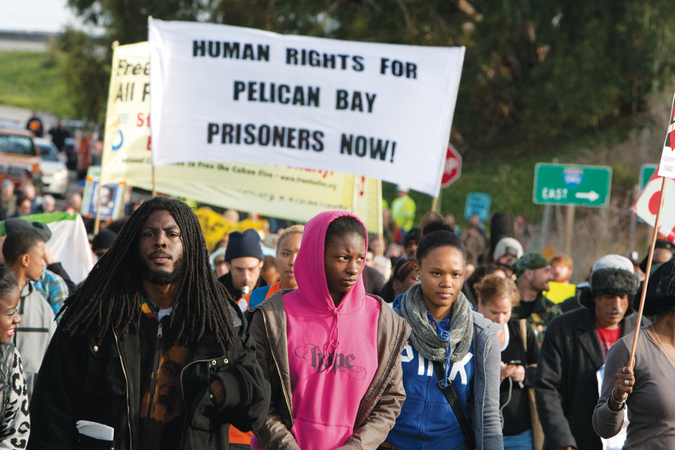 Occupy-San-Quentin-youth-giving-evil-eye-to-cops-022012-13-by-Malaika-web, 1,500 strong march against slavery, Local News & Views