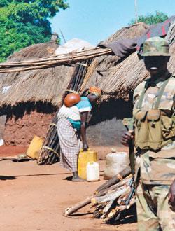 Ugandan-army-soldier_in_Labuje_IDP_camp_Uganda-2002, The problem with 'KONY 2012', World News & Views