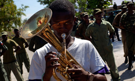 Dissolved-Haitian-army-members-parade-Camp-Lamantin-former-military-base-PAP-by-Ramon-Espinosa-AP, Paramilitary gangs join UN force in preying on Haitian population, World News & Views