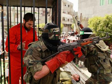 Hamas-militants-stage-mock-prison-break-at-rally-for-prison-hunger-strikers-in-Jabalya-Gaza-041312-by-Mohammed-Salem-Reuters, 1,600 Palestinian prisoners on hunger strike since April 17, World News & Views