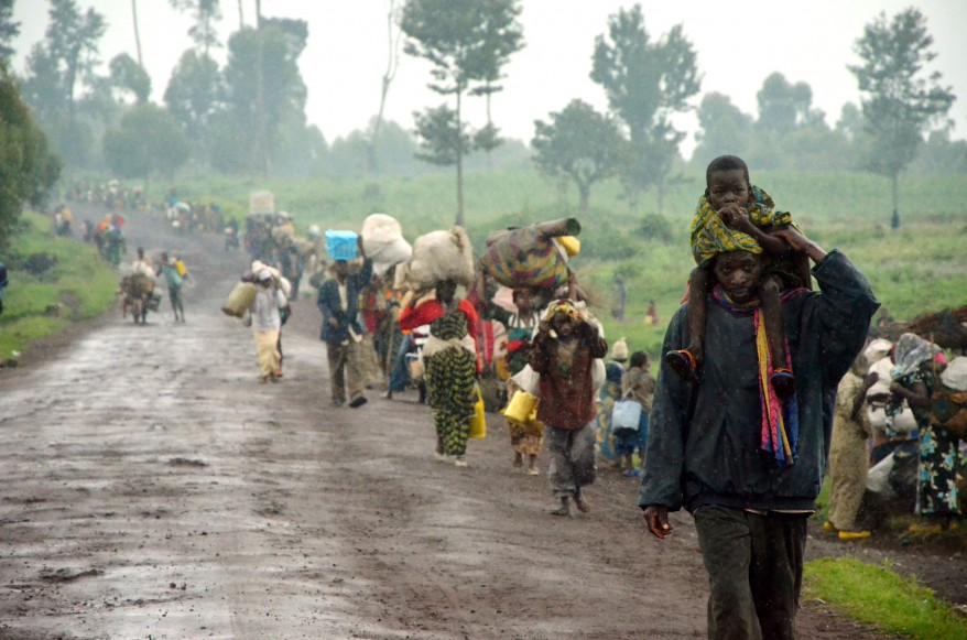 Kibumba-eastern-Congo-residents-walk-to-Goma-fleeing-Bosco-Ntagandas-army-deserters-fighting-Congo-army-FARDC-0512-by-AFP, Justice for the Congolese people, an attainable goal in 2012, World News & Views