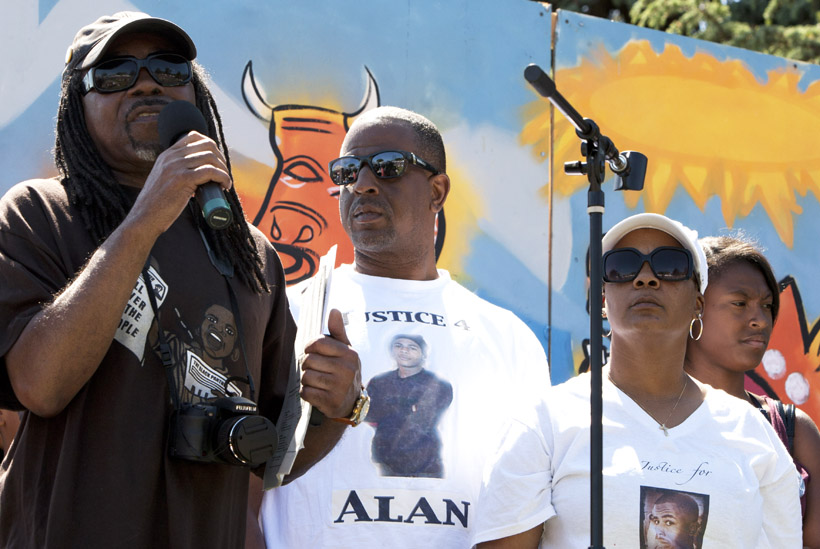Richard-Brown-Adam-Jeralynn-Blueford-speak-for-Alan-at-MX-Jazz-Fest-San-Antonion-Park-Oakland-051912-by-Malaika, Protesting police murder of Alan Blueford and war on Afrikans, Local News & Views
