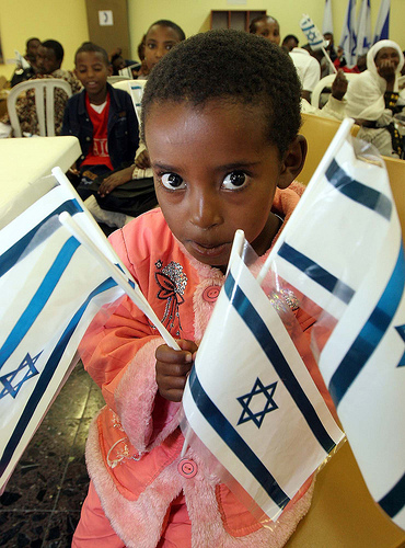 African-lil-boy-w-Israeli-flags, Africans in Israel attacked by Zionist government and racist mobs, World News & Views