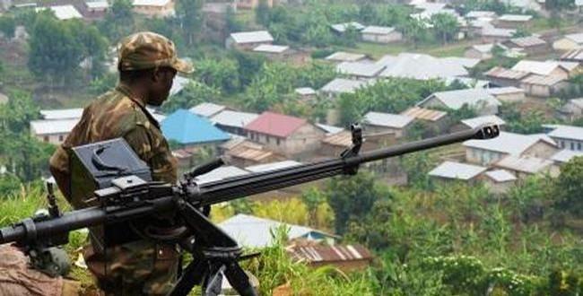 M23-rebel-looks-down-at-Bunagana-DRC-border-town-0712-by-RNW, U.S. cuts aid to Rwanda for destabilizing Congo, World News & Views