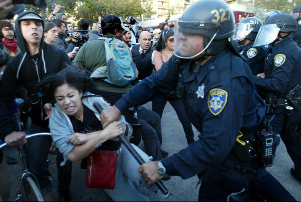 Occupy_Oakland_v._cops_Black_woman_attacked_102511_by_Ray_Chavez_Contra_Costa_Times1, Just when you thought it was SAFE, Behind Enemy Lines