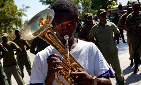 Dissolved_Haitian_army_members_parade_Camp_Lamantin_former_military_base_PAP_by_Ramon_Espinosa_AP, Signs of the times in Haiti: The military, money and meaning of an occupation, World News & Views