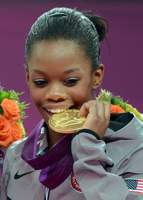 Gabby-Douglas-bites-gold-medal, The power of Gabby Douglas, Culture Currents