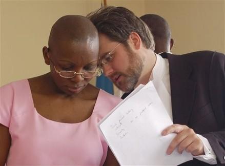Iain-Edwards-Victoire-Ingabire-confer-in-court, Victoire still in prison, Congo still a human catastrophe, World News & Views