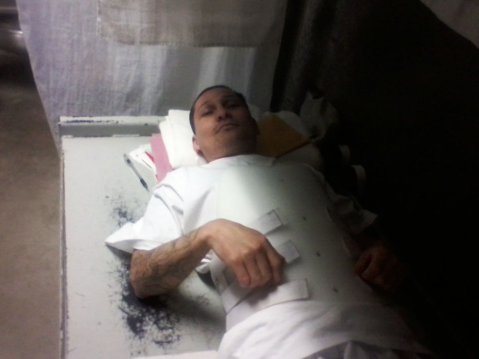Juan_Jaimes_in_brace_on_bare_bed_072312_pic_emailed_to_Kendra, Corcoran hunger strike petitioner Juan Jaimes, who broke his back, now faces 125 years, needs legal help, Behind Enemy Lines