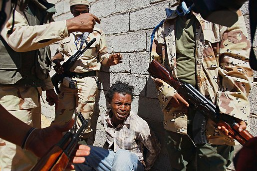 Libyan_troops_arrest_Nigerian_youth_0712, Nigerians are dying in Libyan prisons, say returnees, World News & Views