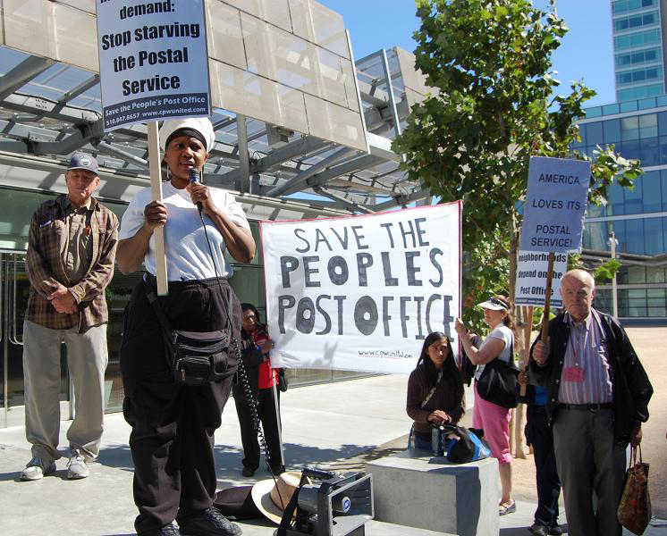 March+to+Save+the+People's+Post+Office+at+Civic+Center+PO+postal+worker+Angela+speaks+062712+by+Patricia+Jackson, Building a powerful nationwide grassroots movement to save the people's Post Office, National News & Views