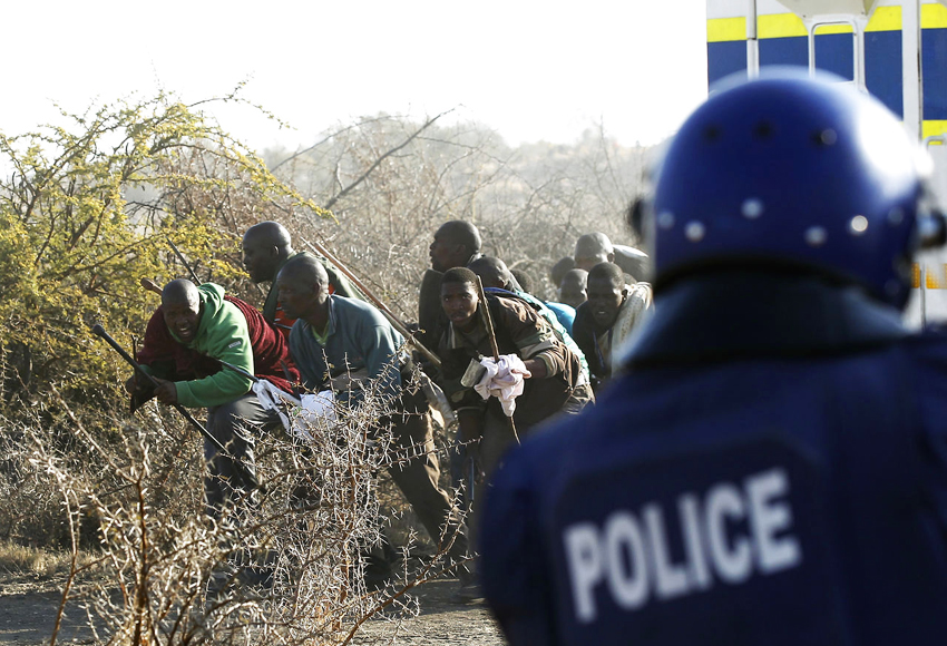 Marikana-mine-workers-cop-prepare-to-attack-081612-by-Siphiwe-Sibeko-Reuters-web, Marikana mine workers massacred by South African police, World News & Views