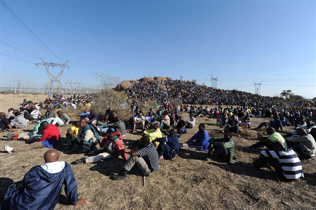 Marikana-mine-workers-sit-in-demanding-living-wage-081612-1-by-AFP, Marikana mine workers massacred by South African police, World News & Views