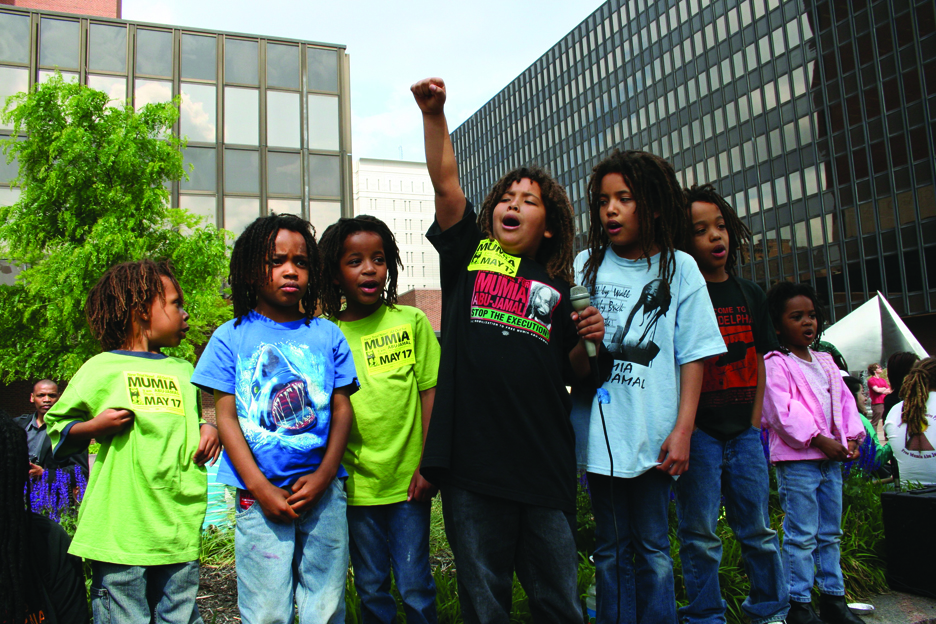 Mumia-rally-Philly-MOVE-kids-051707-by-JR, On the Move! Support the Move 9 on their 34th year of wrongful imprisonment, Behind Enemy Lines