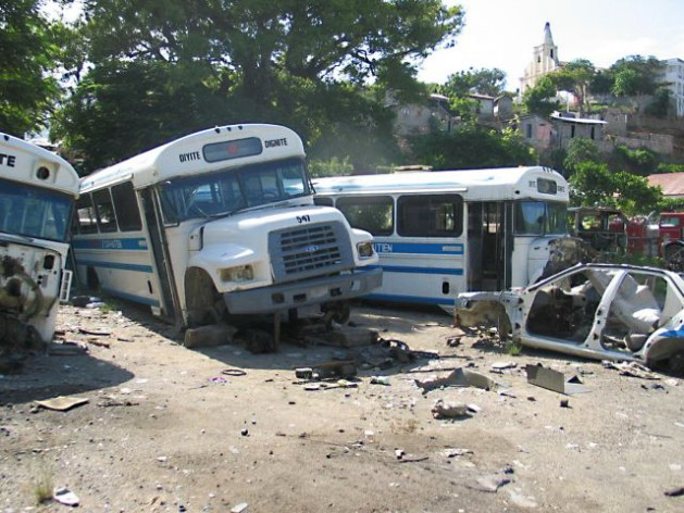 Aristide's-free-school-buses-destroyed-by-paramilitaries-Cap-Haitian-0804-by-Judith-Scherr, Book exposes violent role of paramilitaries in Haiti, World News & Views