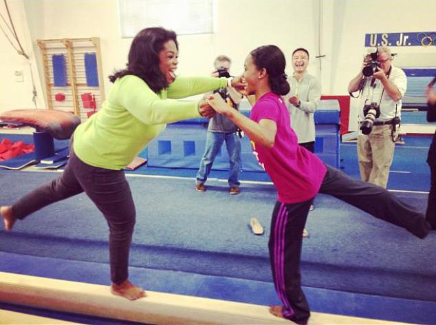 gabby douglas shows oprah winfrey a few moves on the balance beam she told oprah too about the bullying photo oprah winfrey via twitter