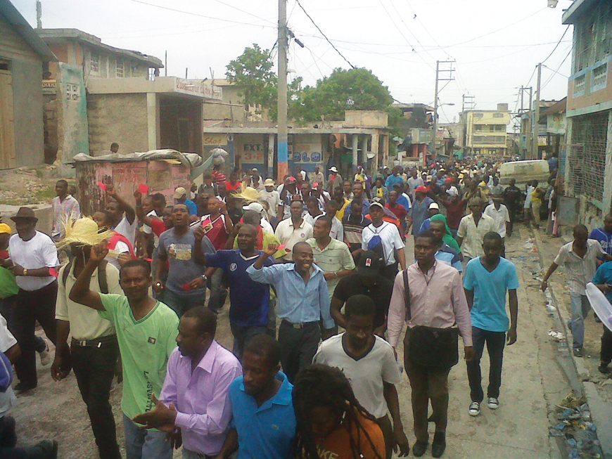 Haitians_march_in_Gonaives_against_Martelly_on_21st_anniv._of_1st_093091_coup_against_Aristide_093012-43, Haiti's constitutional horror show, World News & Views