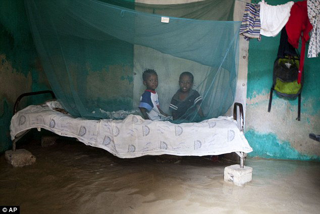 Hurricane_Sandy_PAP_Haiti_children_on_cot_in_flooded_home_102512_by_AP, Hurricane Sandy wreaked havoc on more than just NYC, World News & Views