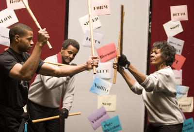 Sifu_Bill_Owens_son_William_wife_Mary_demonstrate_his_martial_art_form_Kusema_Vijiti_The_Talking_Sticks_041111_by_D._Ross_Cameron_Oakland_Trib2, Bill Owens of Cascos Martial Arts Academy is in financial trouble, Culture Currents