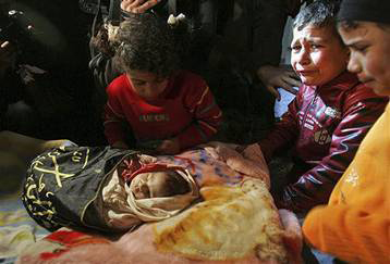 Gaza-children-mourn-dead-baby-1114121, Amid calls for more war crimes, Israel minister hopes attacks will 'reformat' Gaza, World News & Views