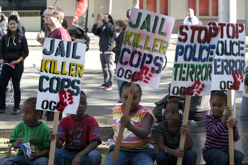 Justice-4-Alan-Blueford-babies-with-signs-at-rally-111012-by-Malaika-web, Justice 4 Alan Blueford – JAB – power punching the Oakland PD, Local News & Views